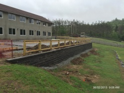 Site retaining wall and railing